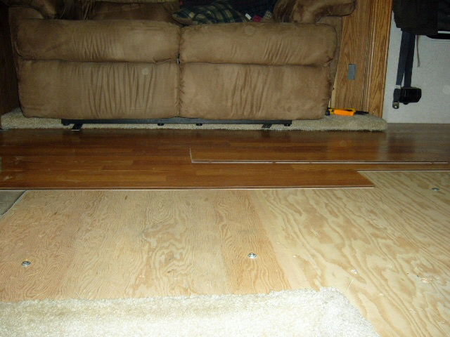 Installing the laminate wood floor.